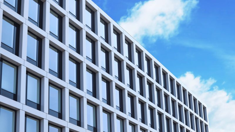 Building with tinted windows, outdoors. Modern architectural design